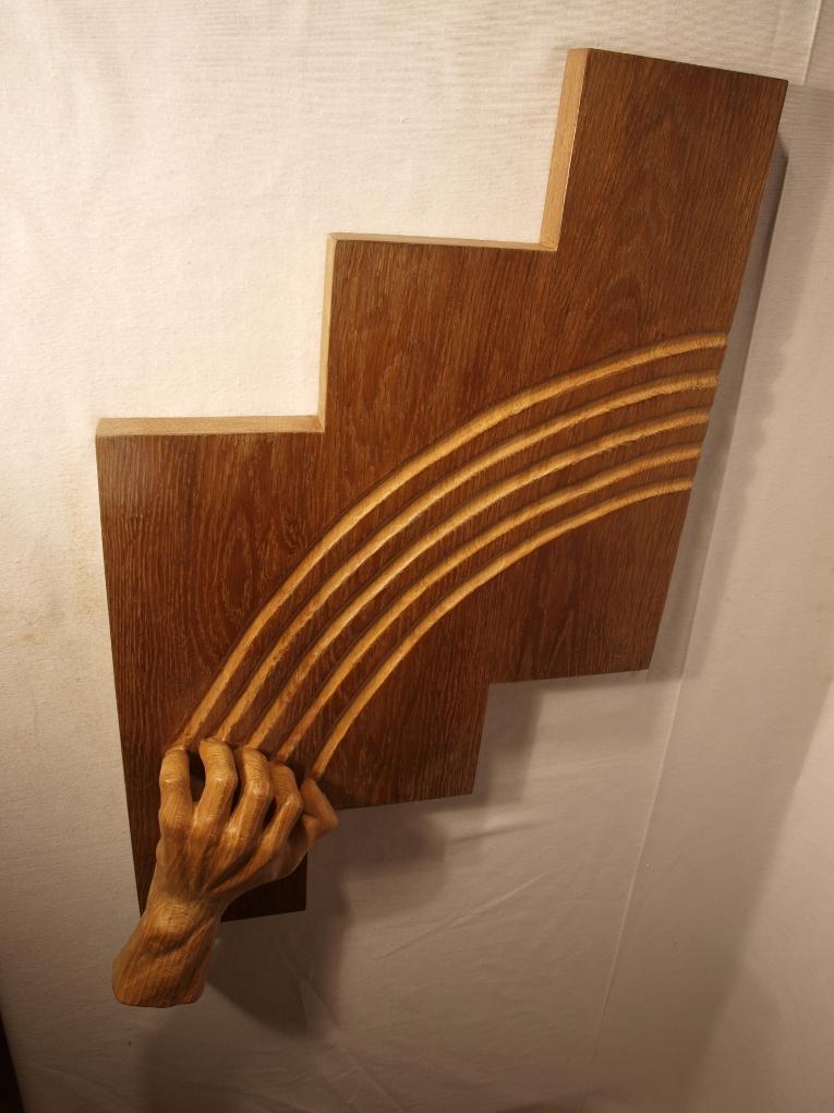 Escultura tallada en madera de roble